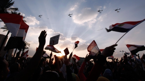 Military helicopters fly above Tahrir Square. Egypt's revolution
